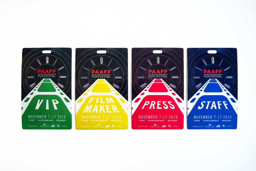 Four PAAFF 2019 festival badges. From left to right: Green VIP badge, yellow Filmmaker badge, red Press badge, blue Staff badge.